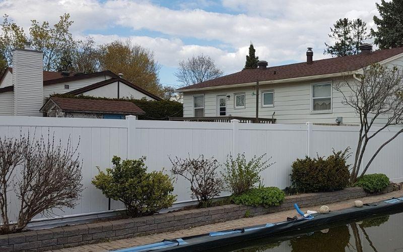 White fence pool